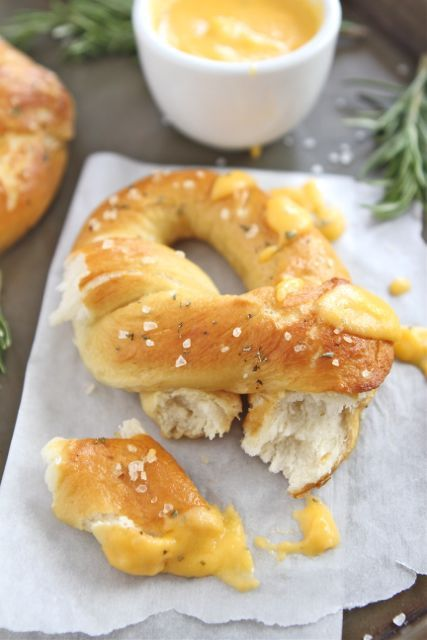 Rosemary Sea Salt Pretzels with Cheese Sauce.  To simplify: make the pretzels from frozen dough and whip up this rosemary-cheddar cheese sauce which looks fantastic.