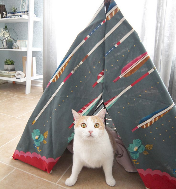 My cat loves small, dark spaces. Only problem is that these kinds of spaces are hard to come by in my open floor plan house. When I came upon a cat teepee in one of the expensive pet boutiques, I knew it was the perfect DIY-able solution.