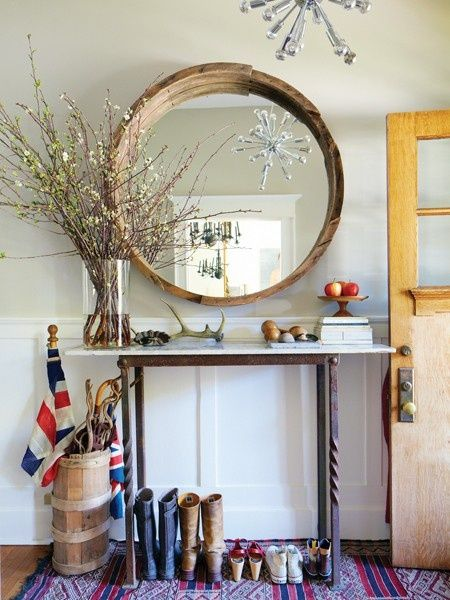 console table.  narrow with flags, antlers, small stuff with impact.  Rustic Wood Round Mirror - love the entry and styling