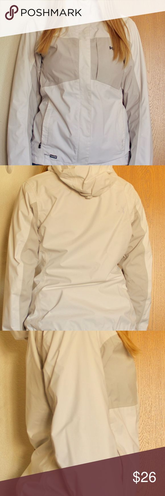 ✅Helly Hansen Packable White Shell Jacket w/Hood ~Helly Hansen Packable Shell ~Stuffs Inside Small Bag Inside The Pocket! ~Size: Women's Small  ~Helly Technology ~Full Zipper Up To Neck ~Breathable Mesh Inside ~Markings On Back Right Shoulder(Pictured Above) ~Bought Brand New ~Good Condition ~Great For Layering ~White & Gray Colors Helly Hansen Jackets & Coats