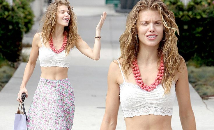 With her hair air dried to reveal her natural curls and her metallic flip flops AnnaLynne looked to have embraced the relaxed style typical of the Californian coastline.
