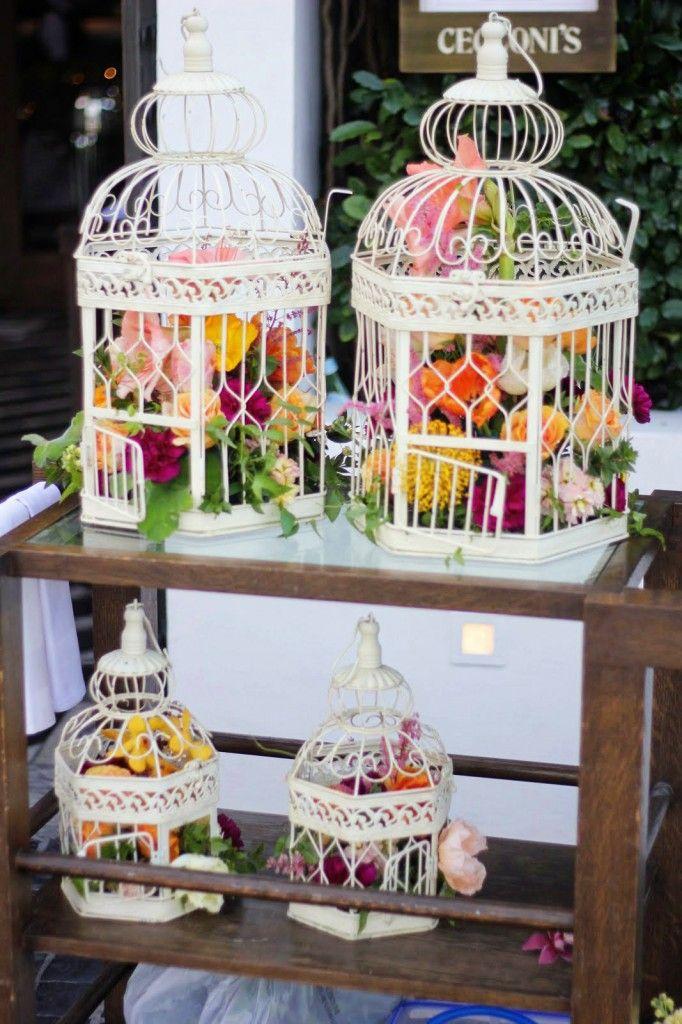 Pretty girl birdcage centerpieces birdcages flower arrangements