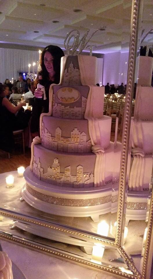 Classic wedding cake meets Batman.  Gotham city. Half bride half grooms cake.