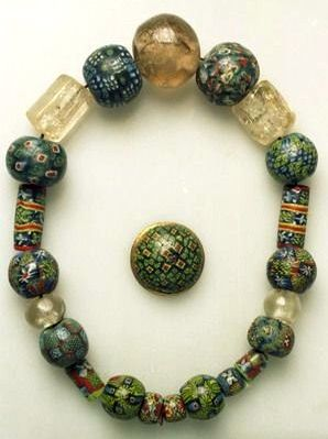 17 beads of glass. Mosaic Beads. Buckle of bronze. Photo Documentation in connection with loans of objects to Nautical Museum, Rørvikneset, Nord-Trøndelag. Norway, Nord-Trøndelag, VIKNA, Ryum.~