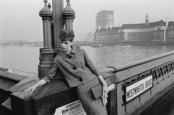 Brian Duffy: Model Judy Dent poses on Westminster Bridge in a checked skirt suit, 2nd January 1961 during a fashion shoot for Vogue