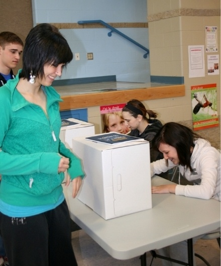 Ashley St. Laurent casts a ballot in the Student Vote mock election at École du Sommet on Thursday.