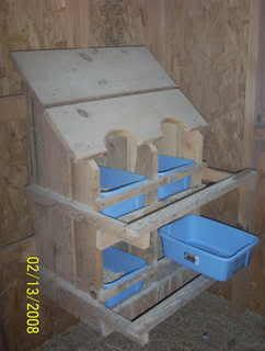 """Line"" the nesting boxes with plastic bins for easy cleaning.....just dump, wash & refill with straw."