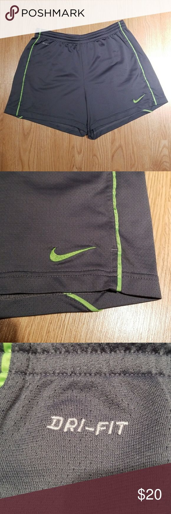 NIKE DRI FIT Grey Neon Green Shorts Gym Large I have here this super cute comfortable grey and neon green athletic shorts from NIKE DRI FIT and is a size Large. These are great for the gym or just to lounge around in at home. There are no / low signs of wear, no stains or rips.  I LOVE OFFERS! Sorry no trades. Bundle to save. Nike Shorts