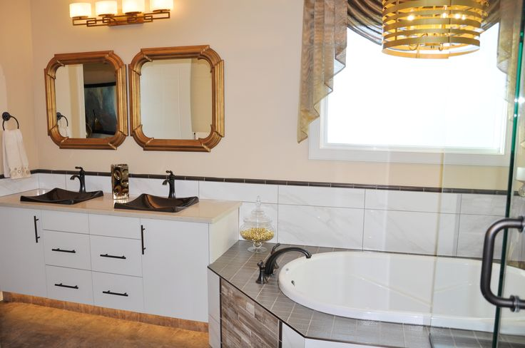 Submission from Abbey Master Builders in Alberta, Canada. This shows one of their homes with 2 of our Hannah Mirrors over the vanity