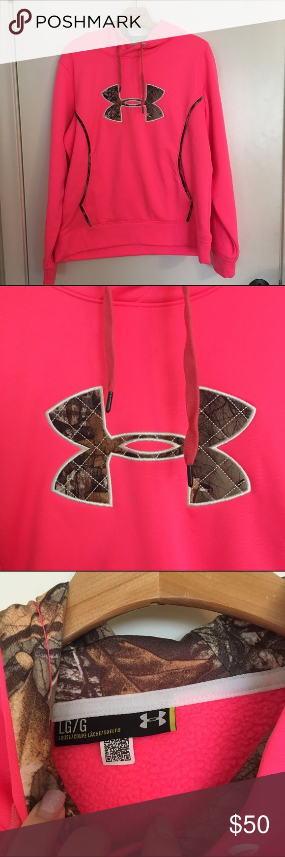 Under Armour hot pink sweater L Great as a comfortable baggy medium. Only worn once. Just too bright for me!! I believe this is water resistant I do not have the tag anymore. Camo hood and detailing. Under Armour Jackets & Coats