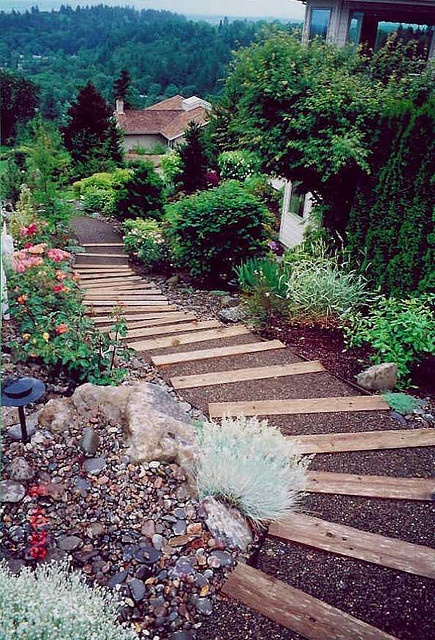 Landscape timber steps with crushed gravel treads.