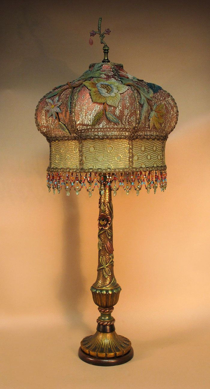 Large Taj Mahal Shade Sits Atop A Vintage Carved Gilded And Painted Wooden Table Lamp With Bas Relief Foliage Twinin