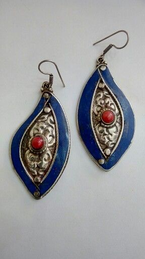 Tibetian earnings  Made in German silver with coral and lapiz Price $20 Email on saagoshroff@gmail.com to avail  (free delivery in India)