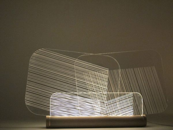 Created by design student Félicie Eymard, the Hide and Seek Lamps remain invisible when you don't need them but when you do, they become a sculptural presence in the room.  The etched plexiglass panels can be moved around to get the look you want. By turning the light on, the panels suddenly generate the linear pattern on the plexi.