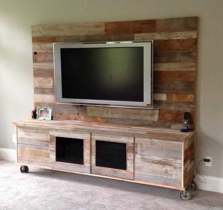 Entertainment center fabricated with reclaimed wood.