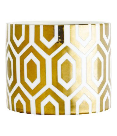Candle in a ceramic holder with a gold print | H&M HOME