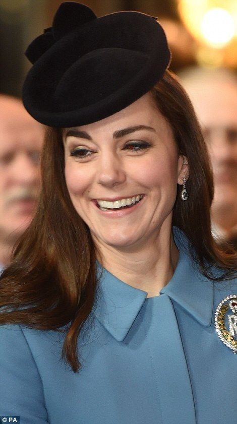 One is amused: Kate appeared to be in good spirits after singing along side the cadets dur...