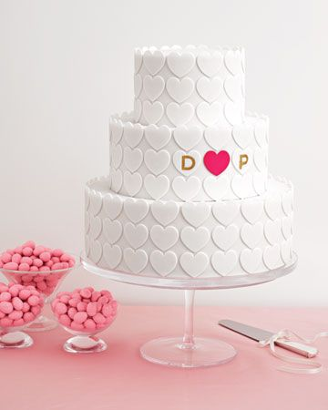 This tiered cake is covered in fondant hearts