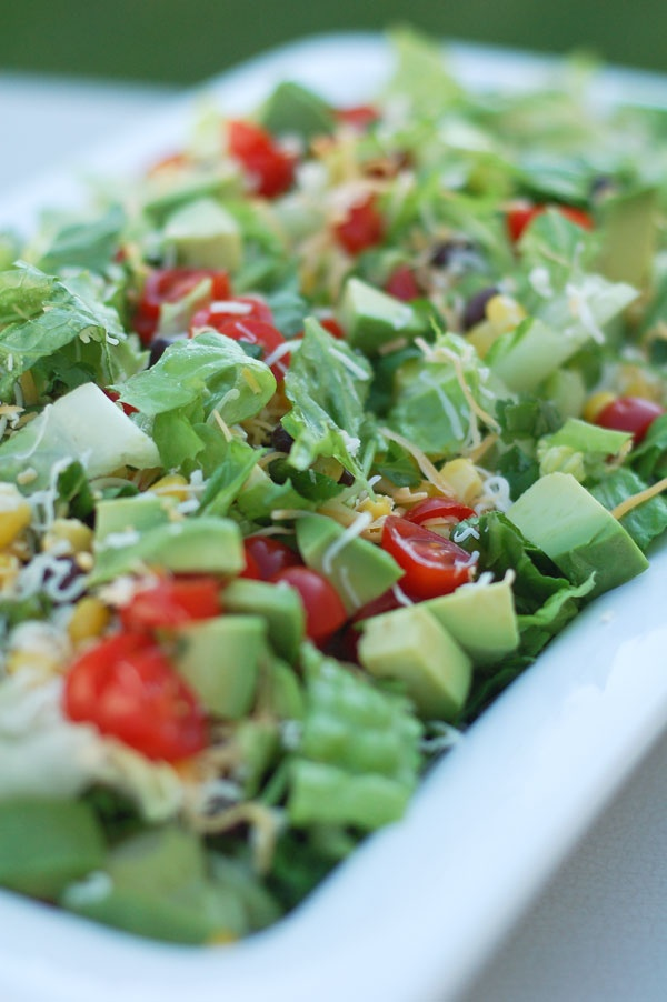 taco salad with fresh tomatoes, corn, and avocado....