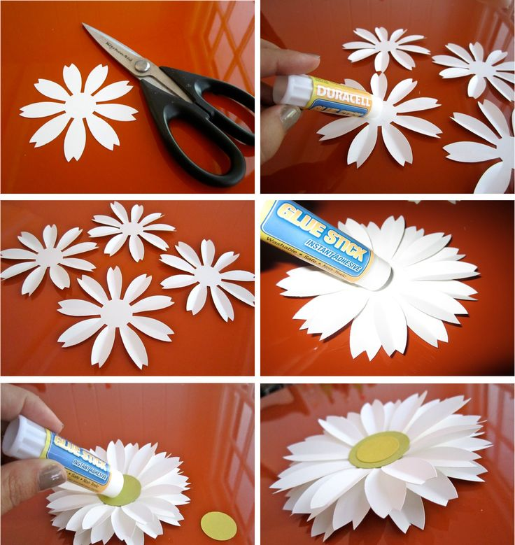 Use a large punch. Notch ends of petals and crease each. Layer 4. Add a center. Attach several to strings (fishing line?) and hang at different lengths over buffet table or on one end of a patio cover, or ...