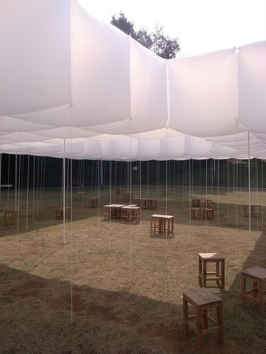 Inflatable cubes.. I can see a handful of people, including myself tripping over the strings! I wonder if you could just hang them instead??