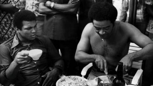 Muhammad Ali and shirtless Bill Withers.
