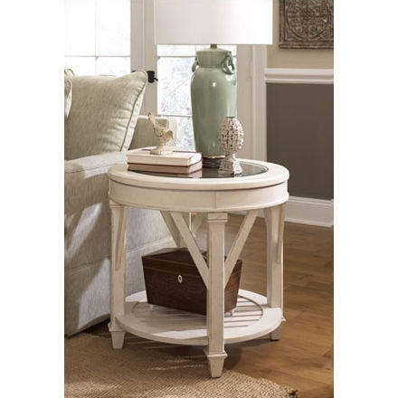 This is one of the side tables in Emily's living room. [Hammary Promenade Round End Table in Antique Linen Finish]