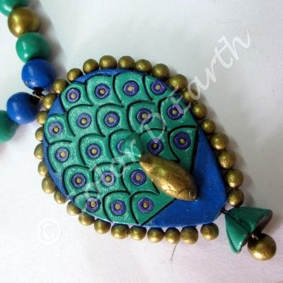 An exquisitely handcrafted peacock Terracotta pendant from www.colordearth.com