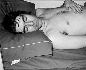 Jill Furmanovsky Oasis: Liam sleeping on tour bus