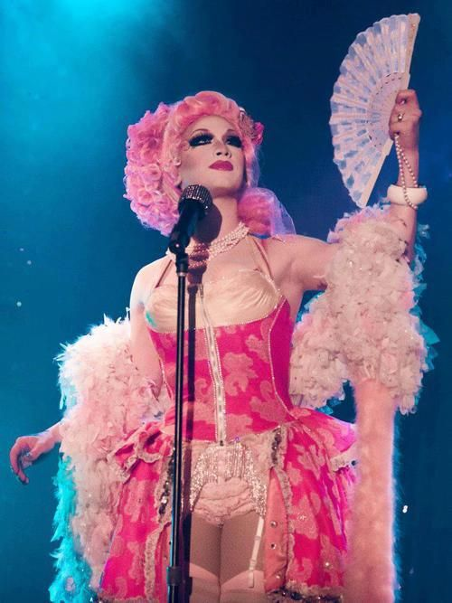 jinkx monsoon  Pink ruffles and feathers and ruffled panties.  He likes dressing up as a girl.