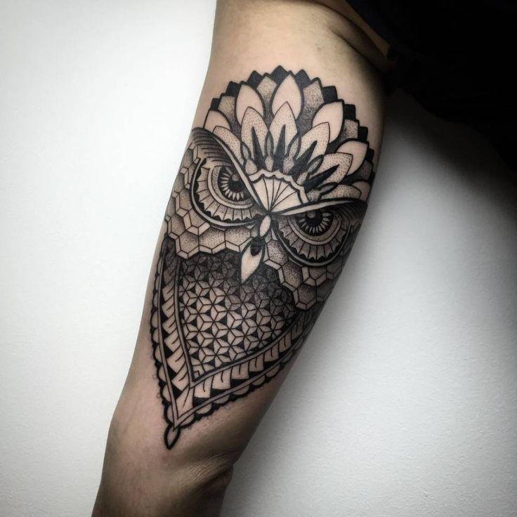 Geometric/blackwork style owl tattoo on the left inner arm. Tattoo artist: Melow Perez