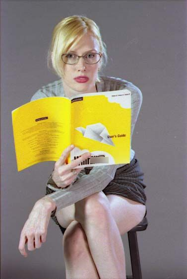 outtake between a shoot I'm reading (look what I'm reading? what a geek! I need my hair done :) #geek #modeling #days #art #fashion #photography