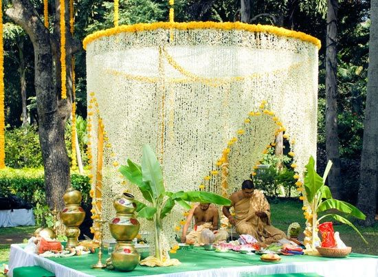 beautiful outdoor mandapam with jasmine and marigolds