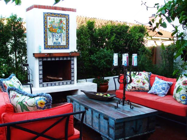 Leanne Michael Interiors created this vibrant courtyard fireplace with Talavera tile.