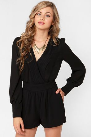 Dresses are great, but do you know what's even better? The Even Better Black Long Sleeve Romper! Black Georgette falls in pretty pleats to a deep V surplice bodice and along the waistline, with slightly puffed, long sleeves that end in pretty covered button cuffs. Keyhole cutout in back has a covered top button closure above a gathered yoke, plus a smocked back waistband. Side pockets. Partially lined. Model is wearing a size small. 100% Polyester. Machine Wash Cold. Imported.