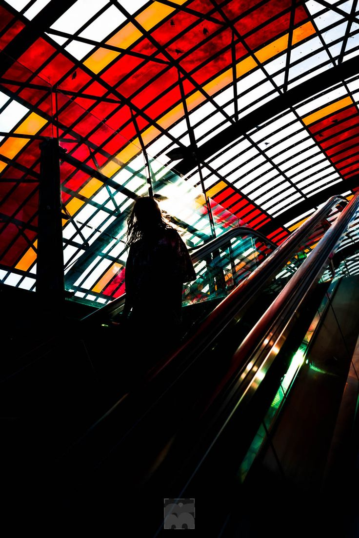 Jesus on an escalator - Shot I took of a guy going down the escalator at Amsterdam central station in the morning light.