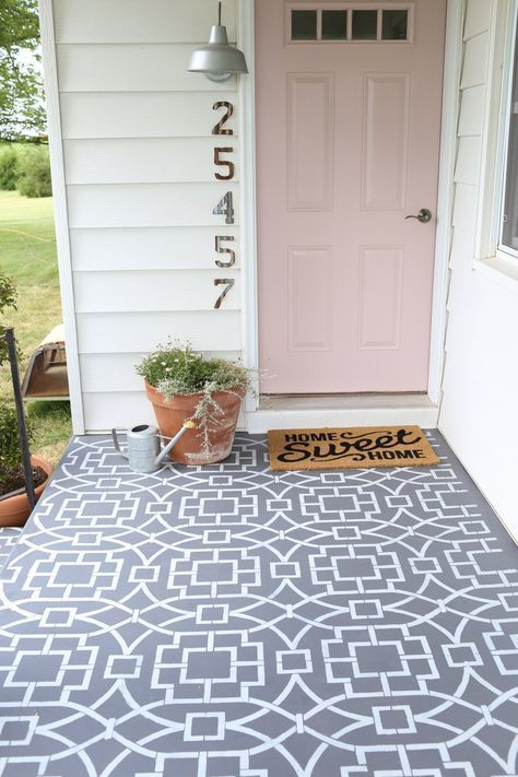 Painted cement floor using a stencil to create a cement tile look.