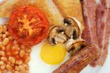 A Full British Breakfast - Eggs, bacon, sausage, Baked Beans, grilled or fried tomatoes, black pudding (Blood Pudding) Fried slice (or Toast) mushrooms and a nice big mug of tea. If you really want a true English, you must try the truckers cafes.
