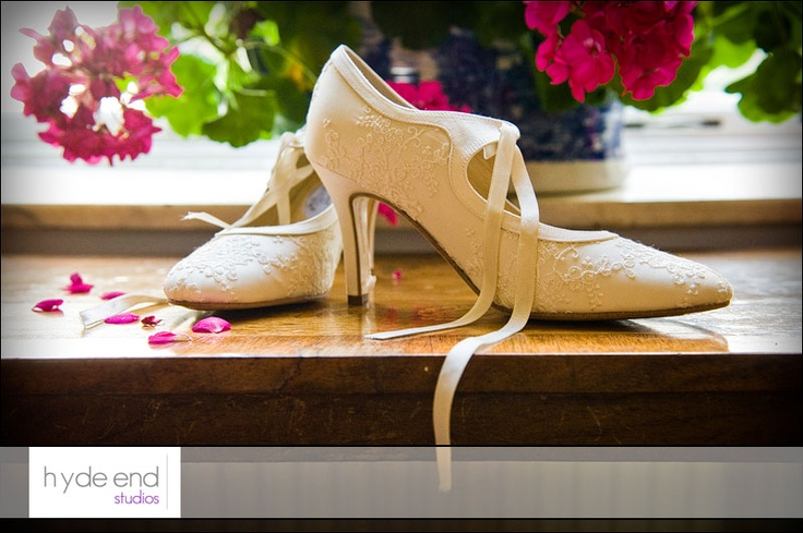 Victoria's beautiful silk wedding shoes photographed on the morning of her wedding at Avington Park in Hampshire.