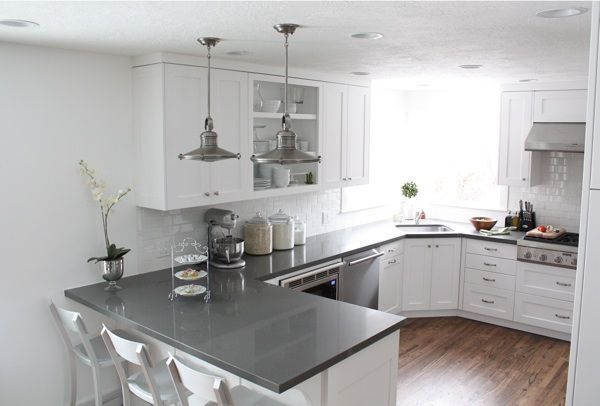 White with gray countertops. Shaker cabinets. These go to the ceiling but with no molding at the top. Although I like a bit of molding at the cabinet ceiling junction, I really like this too. It looks a bit more modern. Corner sink.