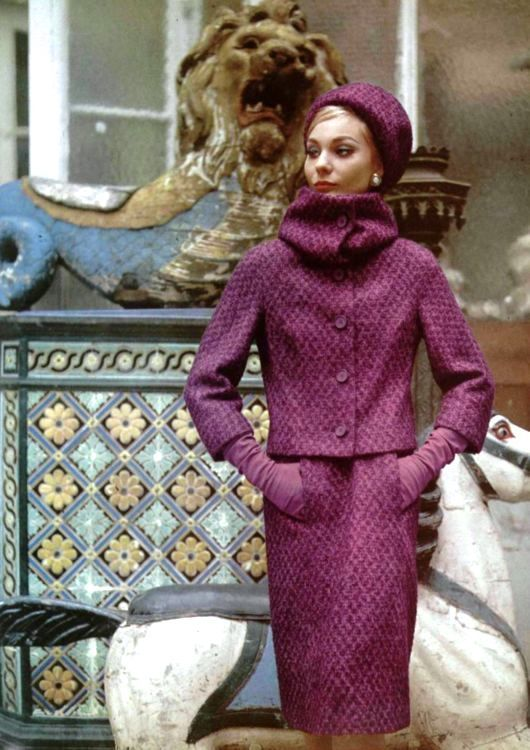 Model in a lovely purple stone-wool suit with high-neck collar by Jacques Heim, photo by Pottier, 1962