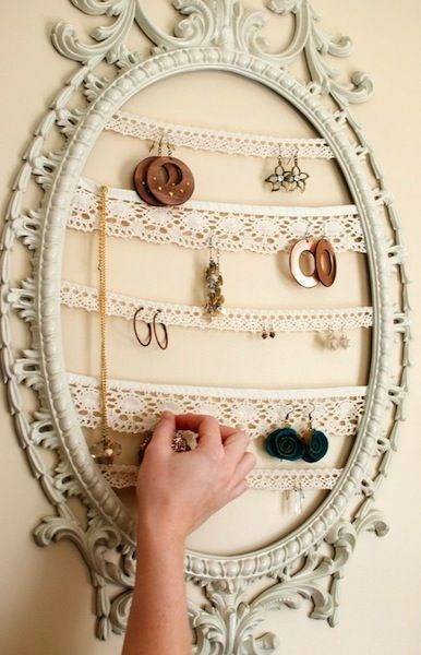 old picture fram, line with lace and hang as to hold earring holder. SO CUTE!!!