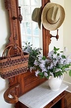 Antique Hall Tree ~ a catch all for hats & a seat to sit down and remove your shoes. The seat opens up to store mittens & scarfs, etc.