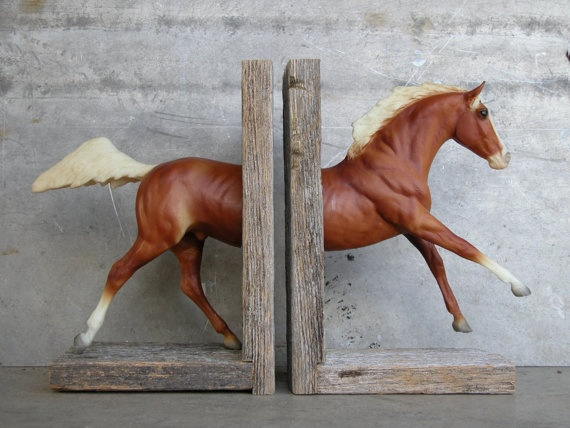 So freaking cool. Breyer Horse bookends.