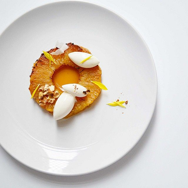 Caramelized pineapple, cardamom honey ginger syrup, coconut sorbet, & cocoa nibs.  by  Johana Langi (langijo) on IG #plating #gastronomy