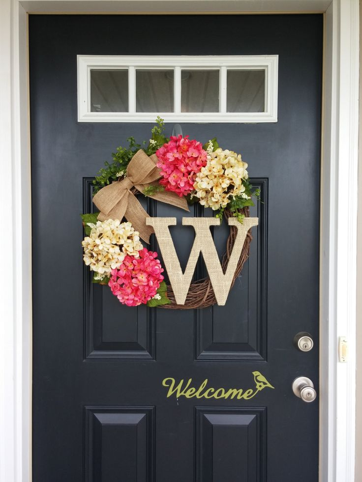 perfect year round on your front door! This wreath is made from a natural 18 grapevine base, a rustic burlap bow, beautiful realistic cream and pink colored hydrangeas, hanging whimsical greenery, and small cream colored berries. Accented with a rustic burlap covered monogram letter of your choice! It measures approximately 20 inches in diameter and 5 inches in depth. Message me about matching wreaths for ...