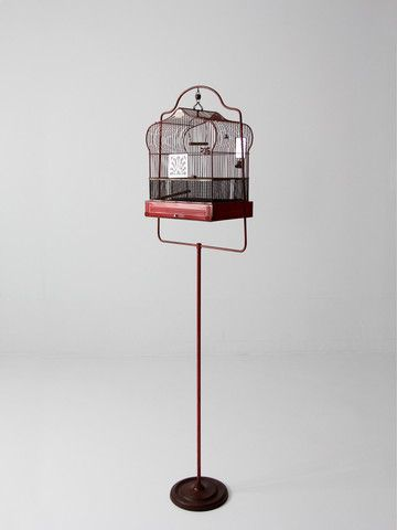 circa 1920s A rare find! This antique bird cage was crafted by Crown. The red metal cage features a matching stand. The cage is a classic Crown style with an arched top and rectangle base. It features