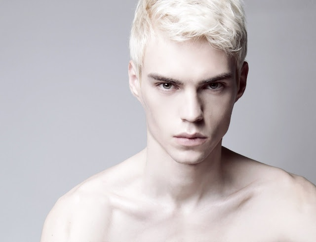 Aean was other worldly. It was almost like he wasn't even human. His hair was stark white, an effect of having your soul ripped out of your body. His eyes glowed a deep amber gold.