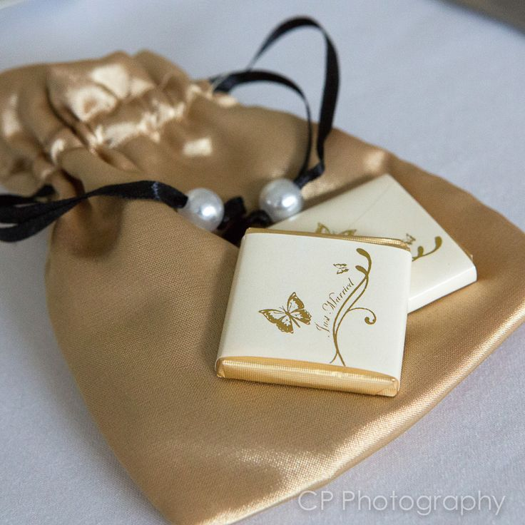 Gold satin wedding favour  bag with two milk chocolate butterfly heart chocolates by www.fuschiadesigns.co.uk.