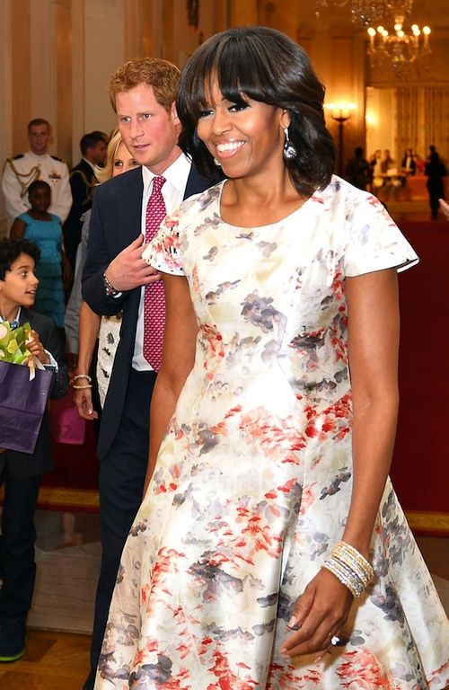 The White House had a sepcial guest today: HRH Prince Harry! Prince Harry joined the First Lady for a White House event to honor military mothers.  On the fashion front, Mrs. O wore a Prabal Gurung Resort 2013 dress, previously seen here. | Mrs. O